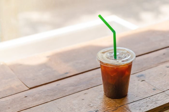 High Angle View Of Iced Coffee On Wooden Table