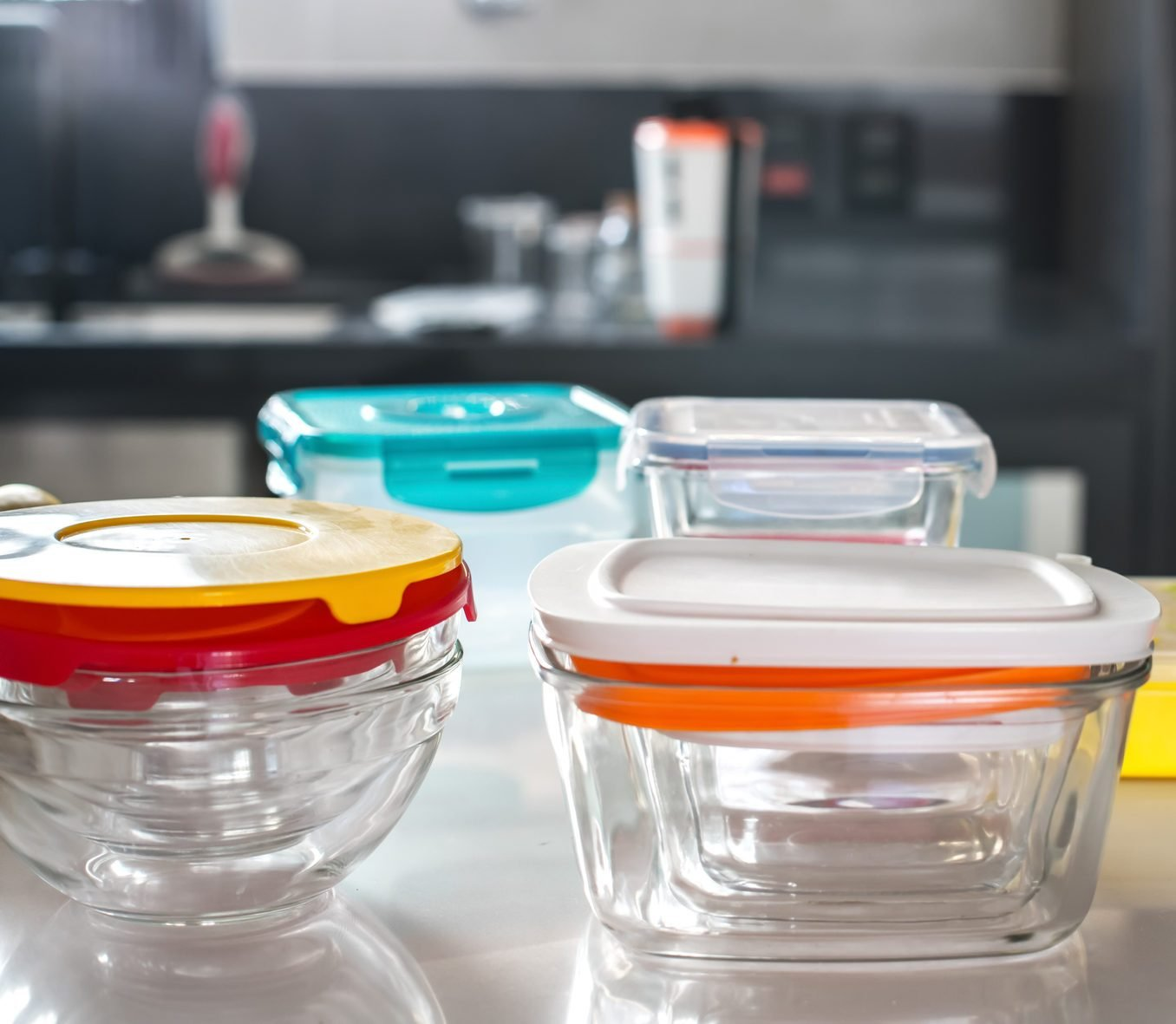 colorful plastic pots on top of kitchen counter