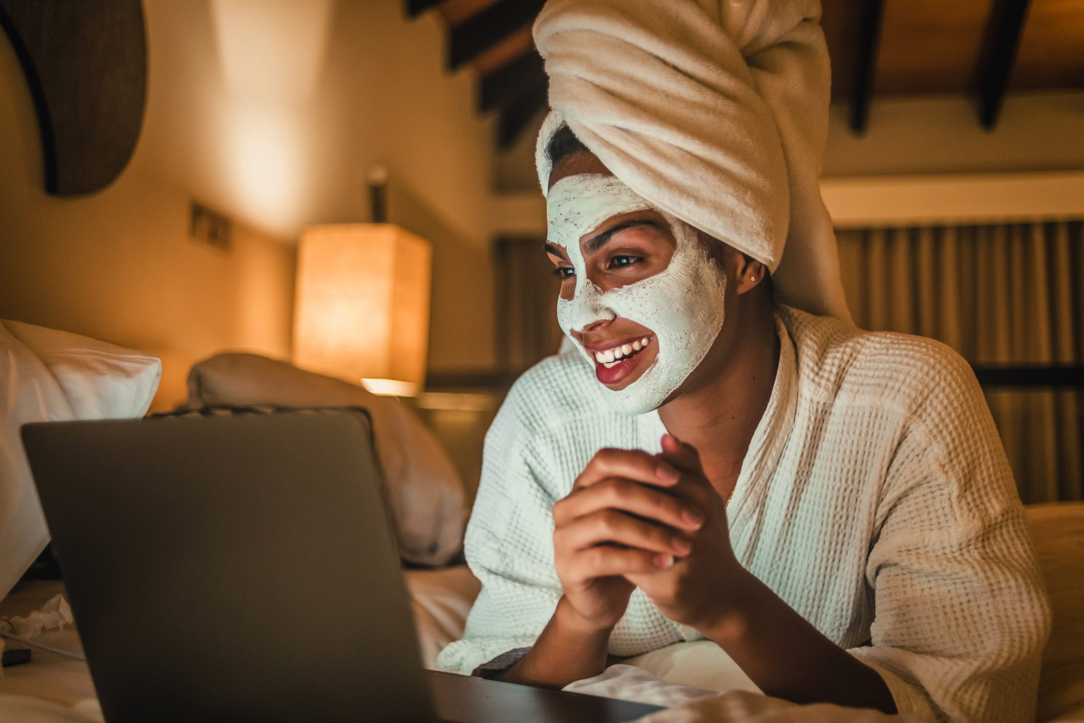woman using her laptop and enjoying at home