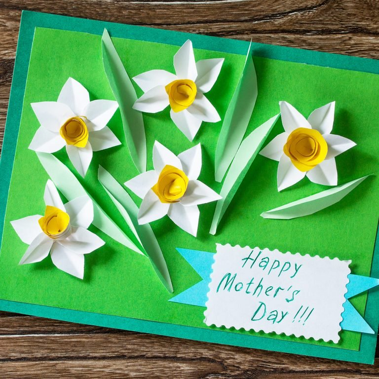 Mother's Day card with daffodils. Handmade. Project of children's creativity, handicrafts, crafts for kids.