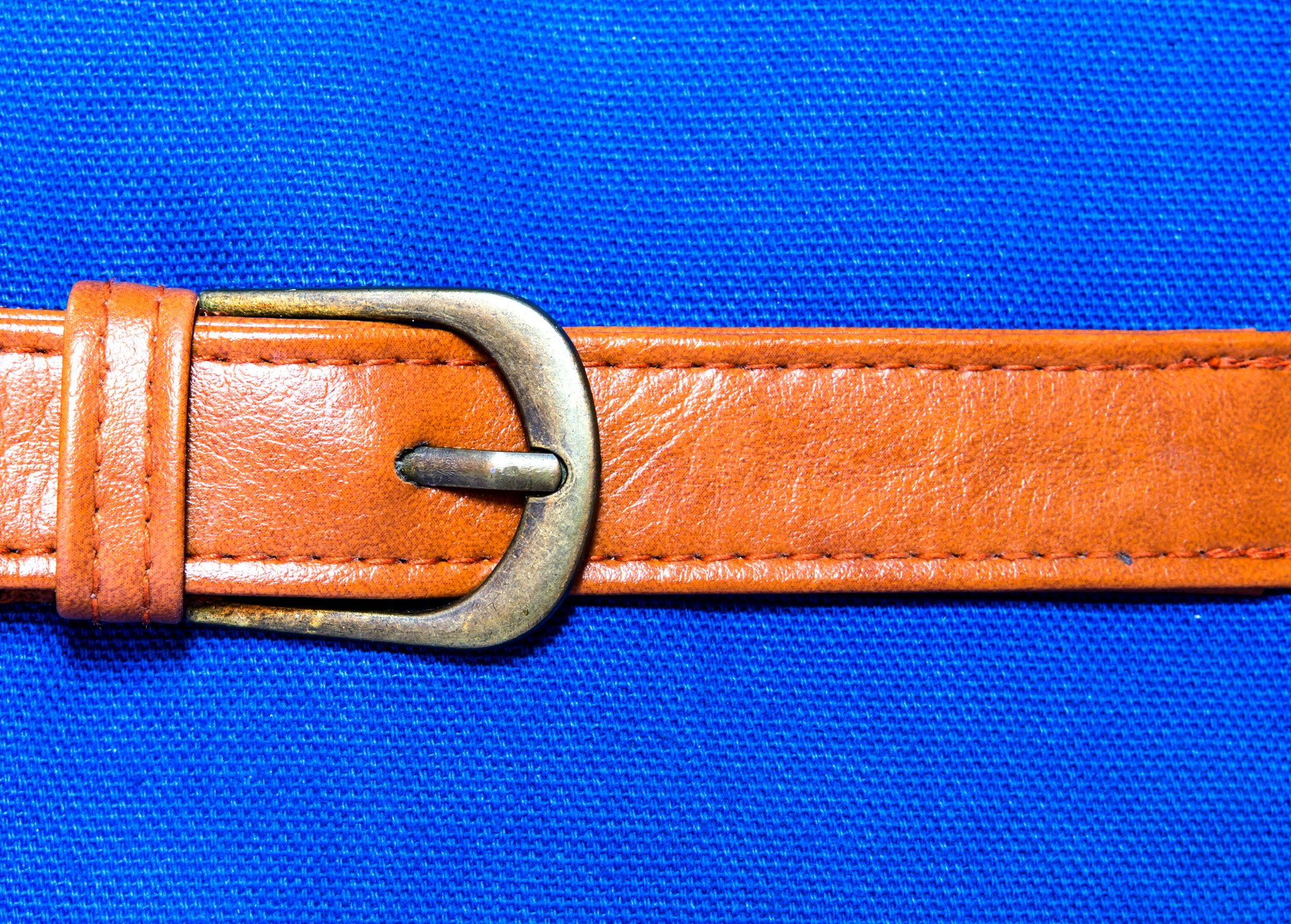 Close-Up Of Belt On Blue Background