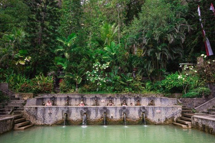 People take a bath in thermal Banjar Tega hot springs. Bali. Indonesia. Southeast Asia. Asia.