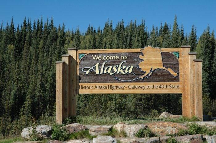 Welcome panel on the Alaska Highway at the Alaskan border