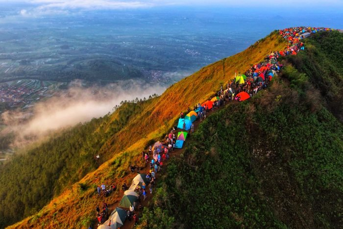 Aerial View Of Crowd Camping On Mountain