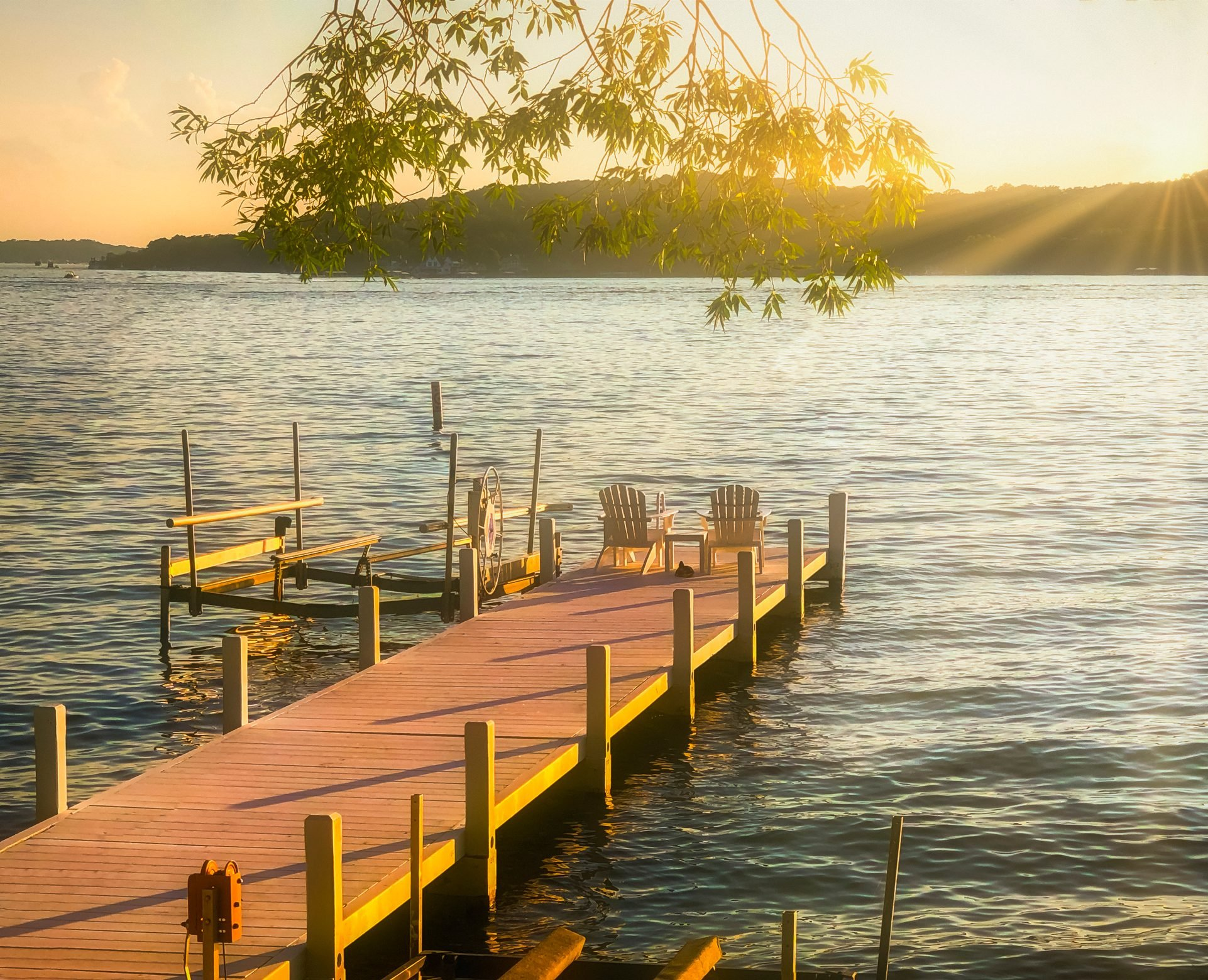 Lake Geneva Pier with Chairs at Sunset