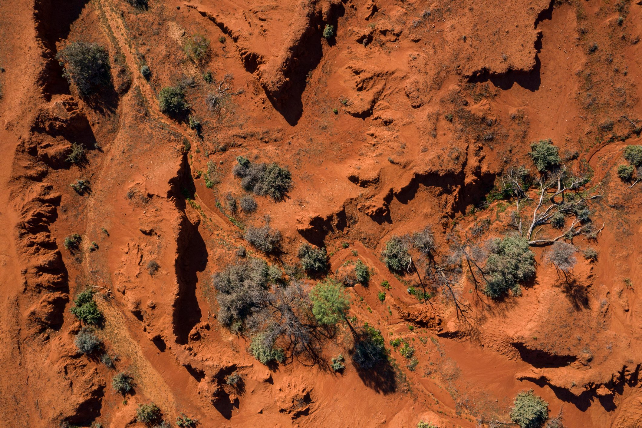 Drone point of view over the red earth of the Australian Outback