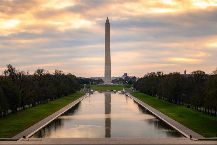Washington Monument on the Reflecting Pool in Washington, DC, USA at dawn.