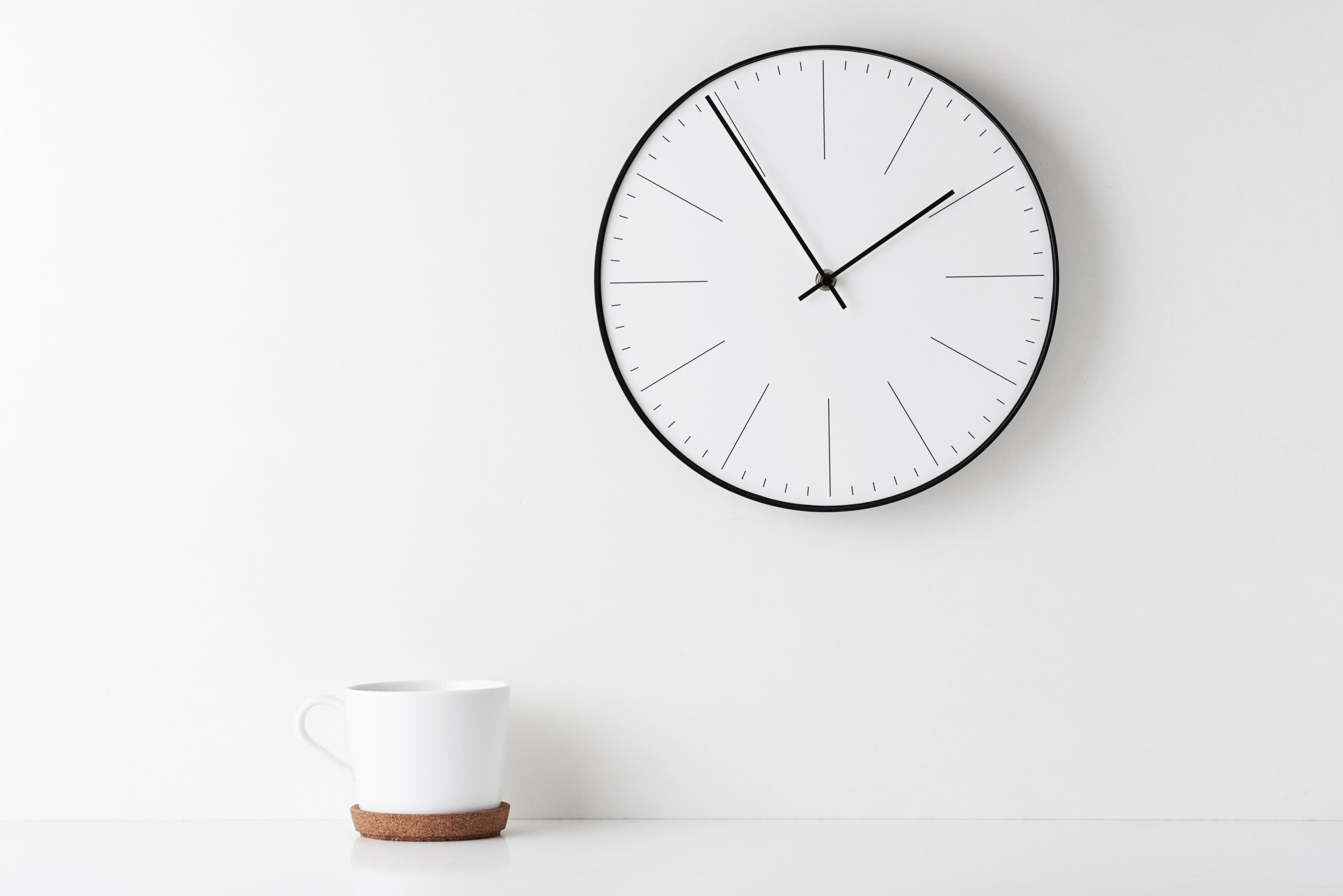 Close-Up Of Coffee Cup On Table Wall With Clock