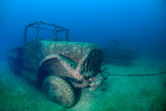 A military truck sunken as artificial reef at a dive site in Thailand
