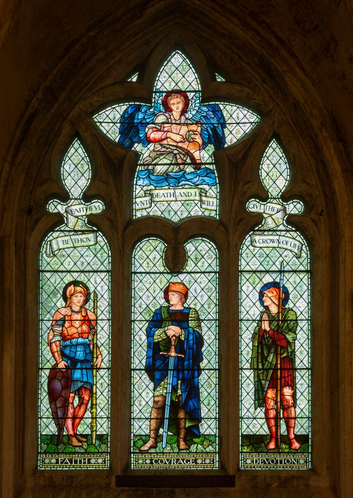 Stained glass window in Malmesbury abbey, Wiltshire, England, UK, Faith, Courage, Devotion by William Morris company c 1900