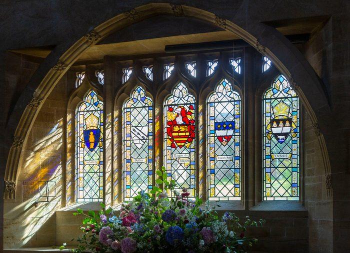 Heraldic stained glass window Inkpen church, Berkshire, England, UK