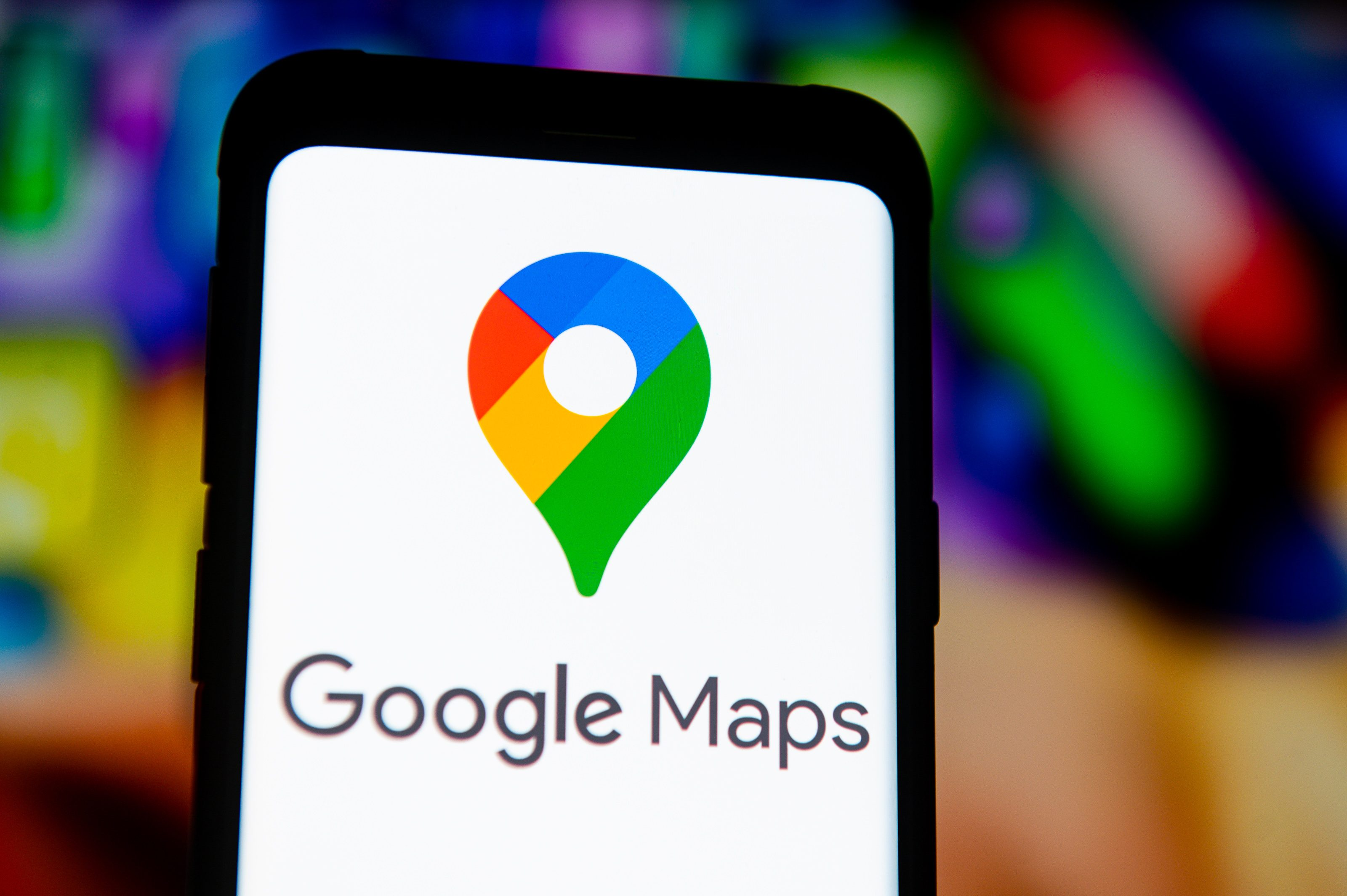 In this photo illustration a Google Maps logo seen displayed...