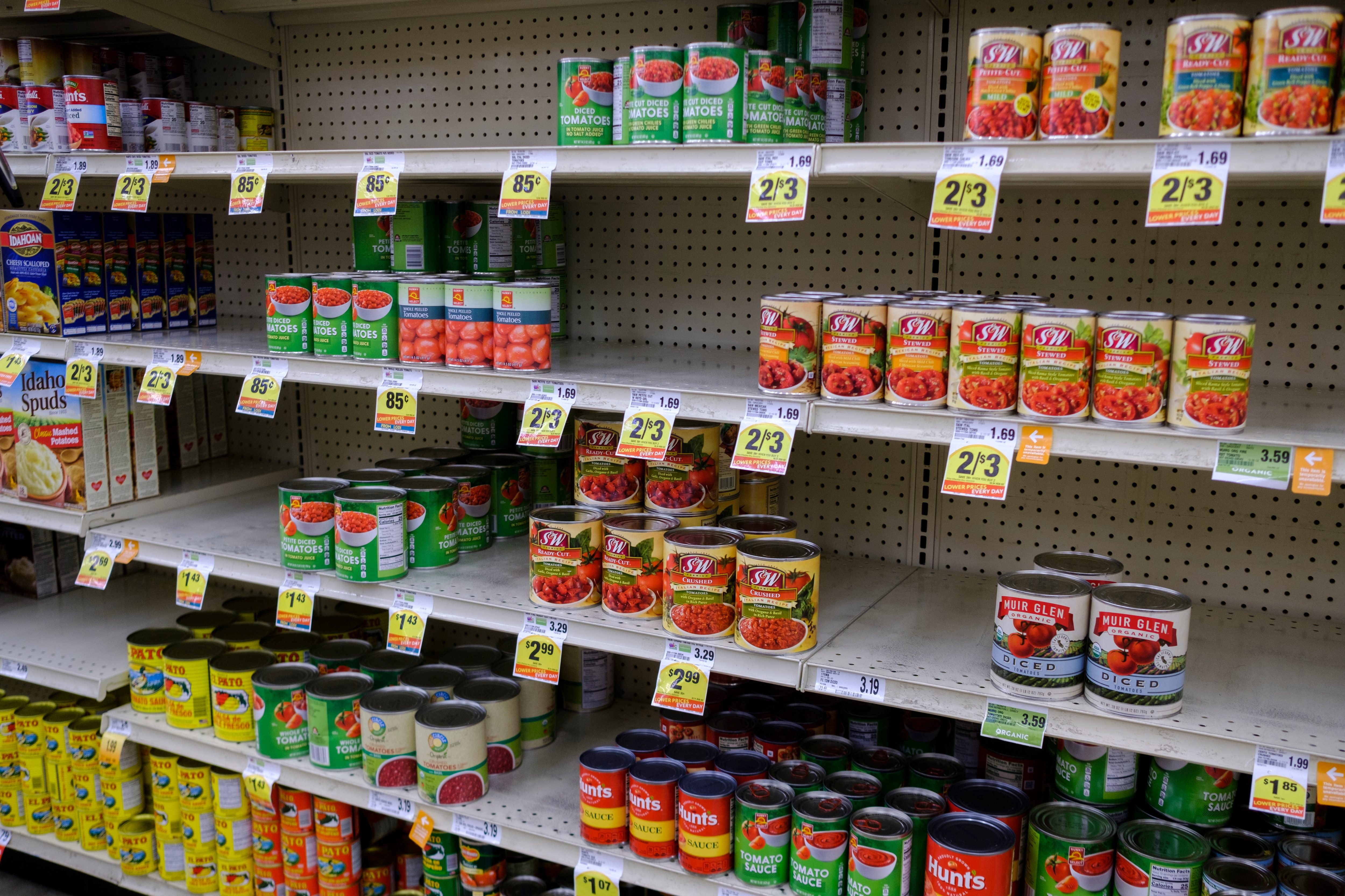 Canned vegetable shelves are partially empty at a Save Mart...
