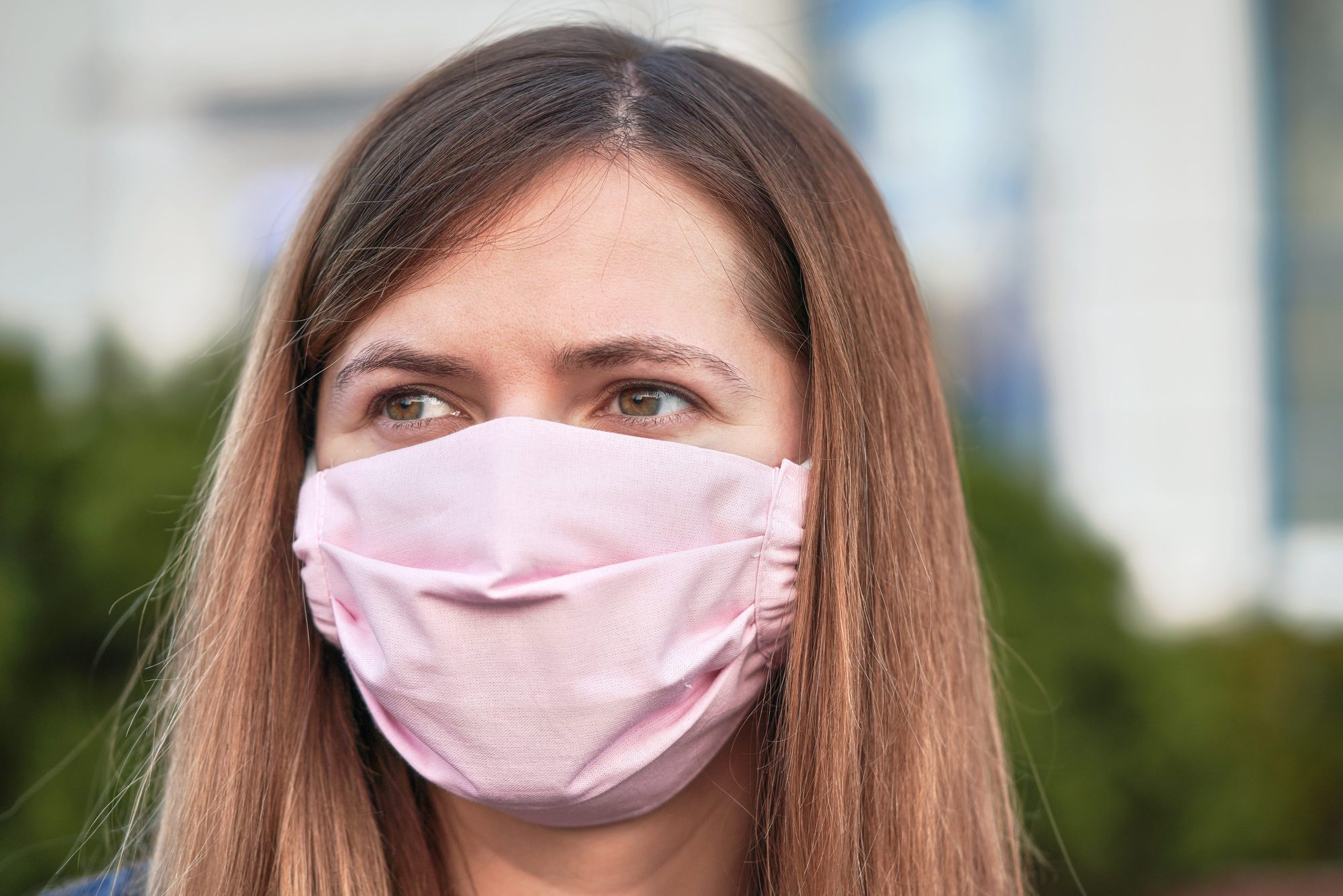 Young woman with hand made face nose mouth mask portrait, can be used during coronavirus covid19 outbreak prevention