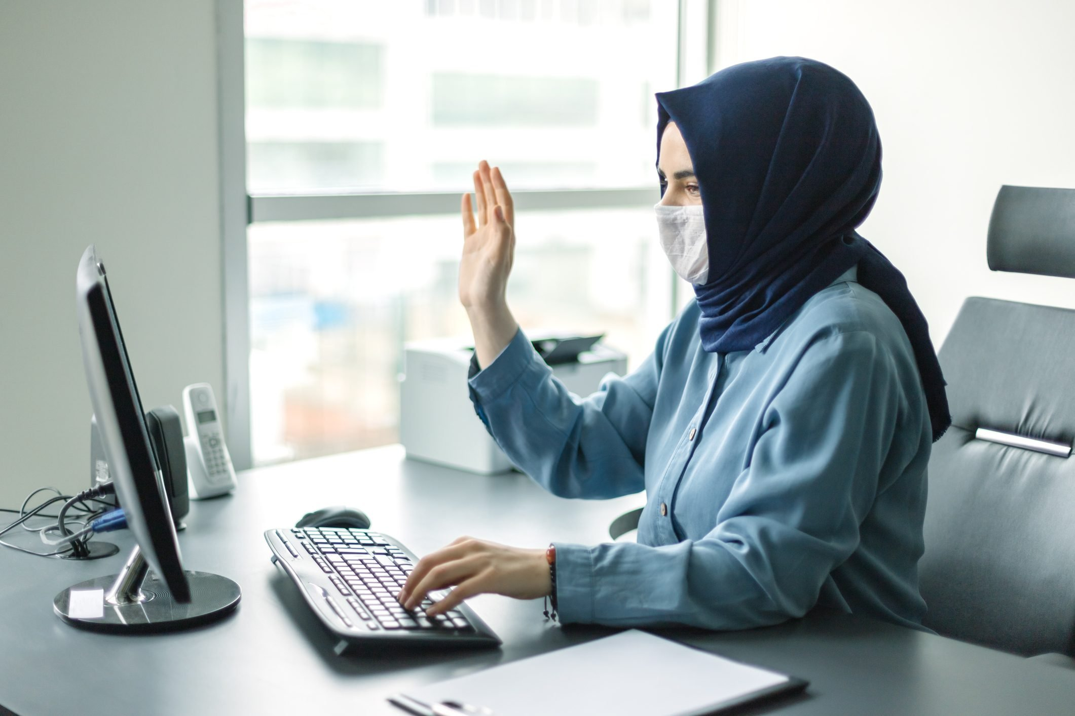 Muslim girl in hijab making global connections