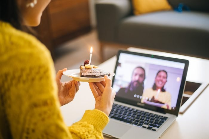 Woman celebrating birthday with video conference