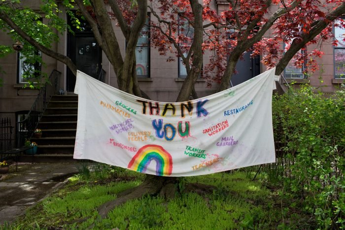 A hand painted sign thanking all essential workers during the COVID-19 pandemic decorates a front lawn on May 3, 2020 in the Carroll Gardens neighborhood of Brooklyn, New York.