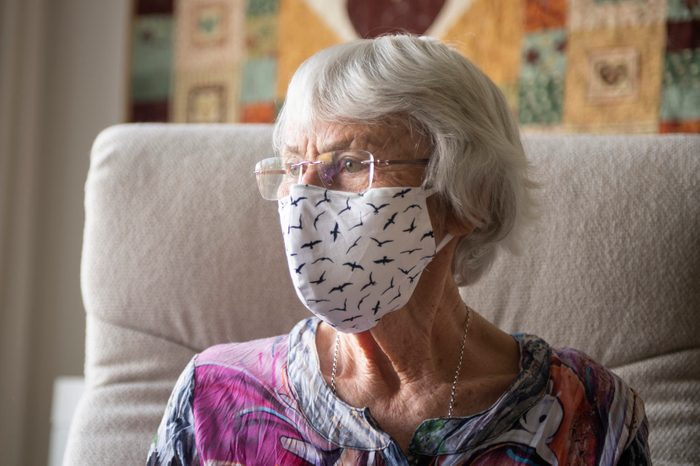 Senior woman with a home made face mask