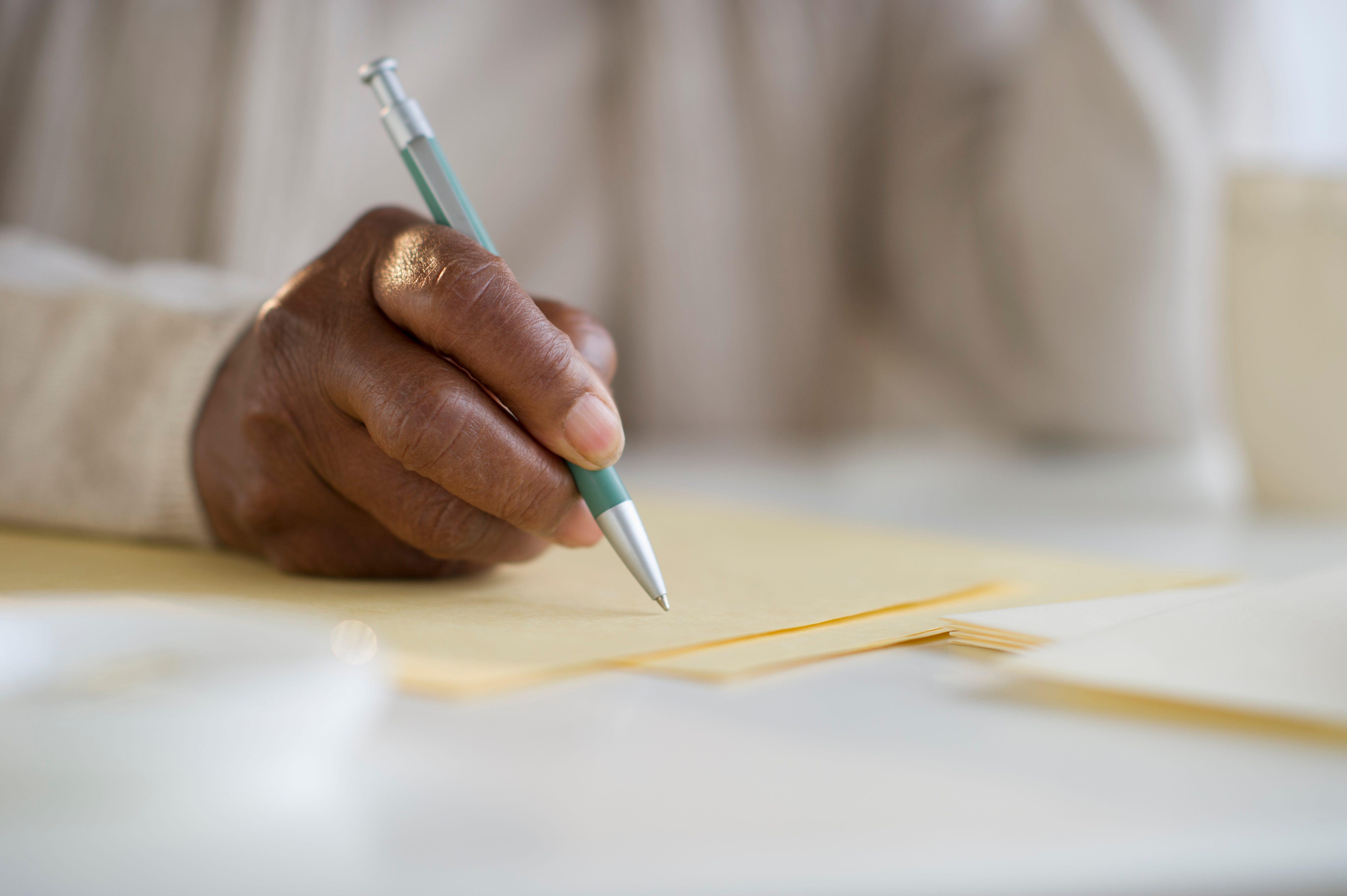 Black woman writing letter