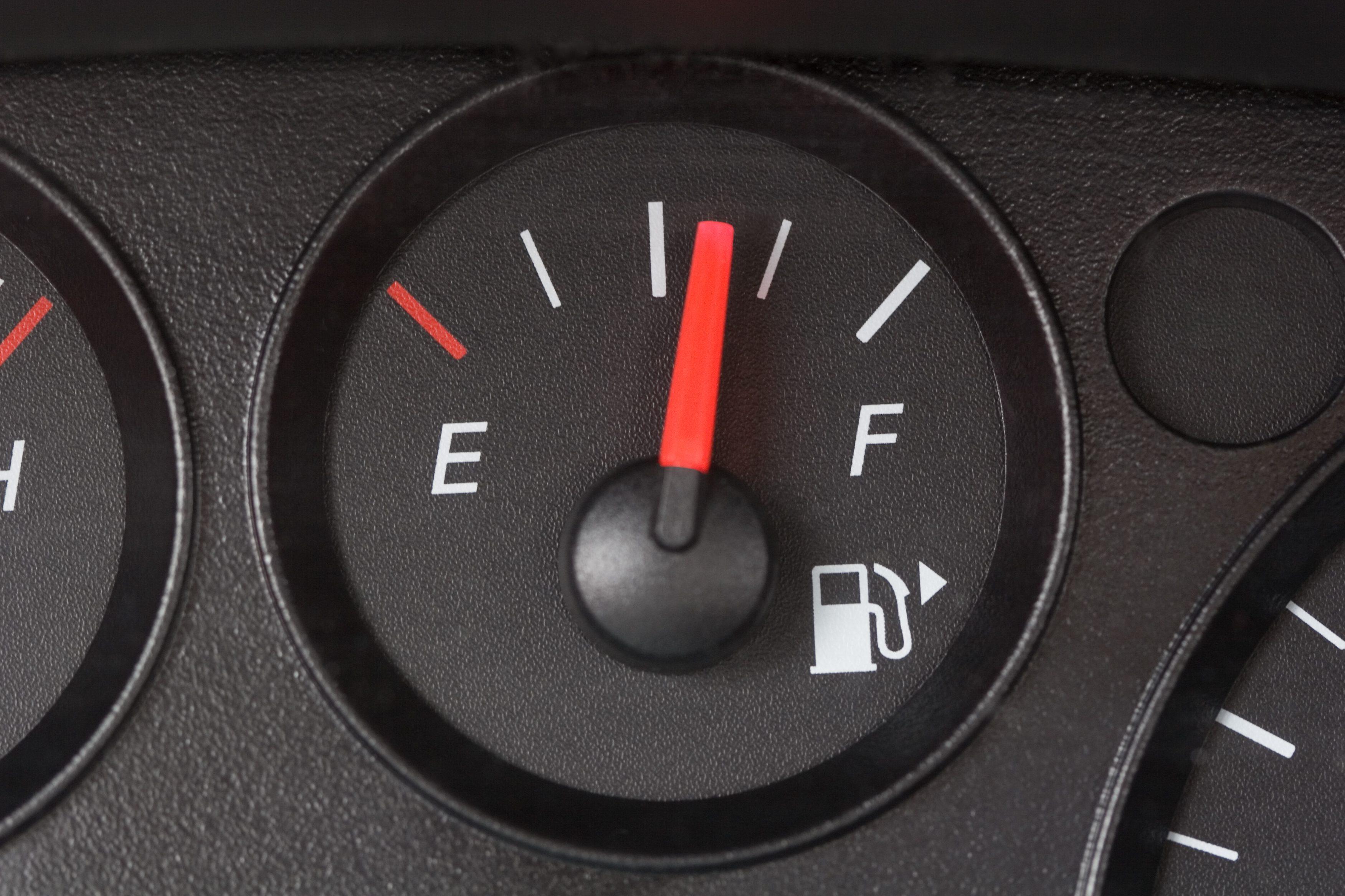 Black Fuel Gauge with Red Marker Over Half Full