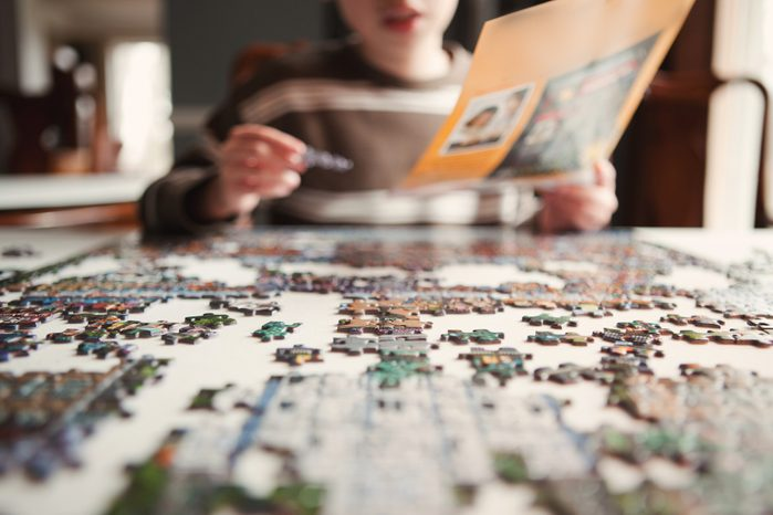 Boy working on Puzzle