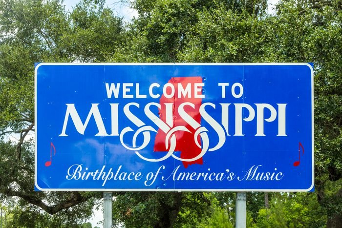 Welcome to Mississippi sign in blue and red