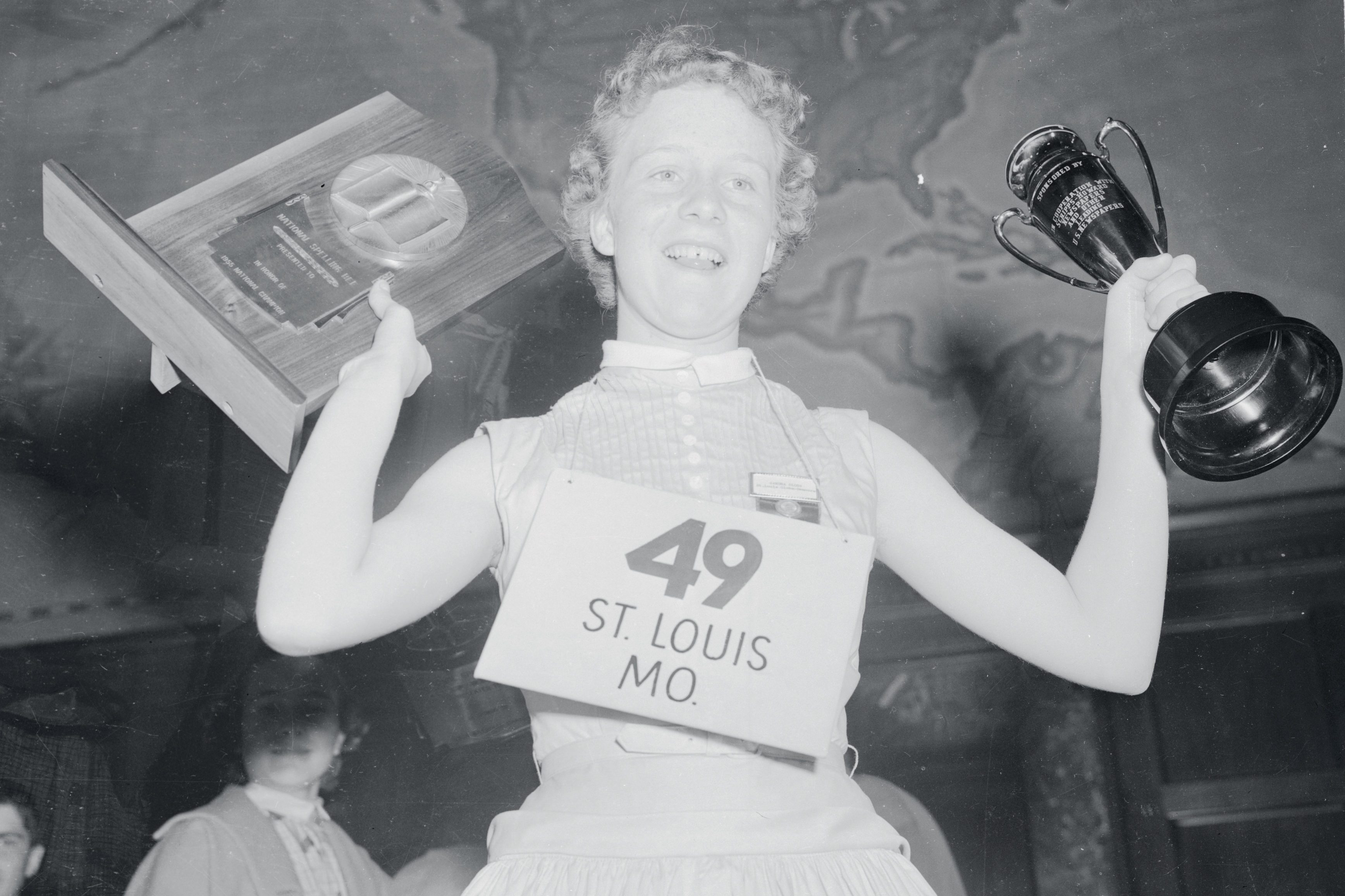 Girl Holding Trophy Cup and Plaque