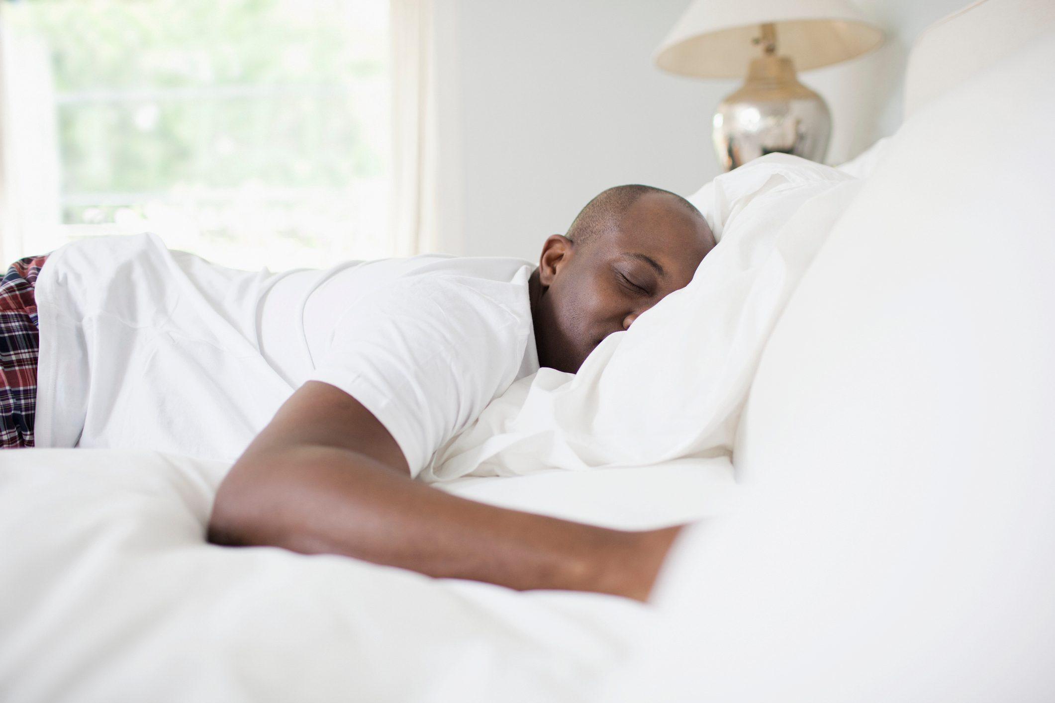 Man asleep in bedroom