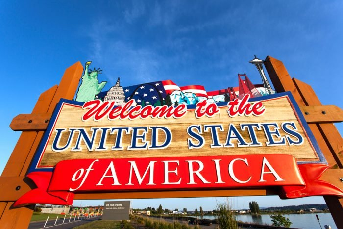 USA, Washington, Blaine, Welcome to the United States of America sign at US- Canada border on summer evening
