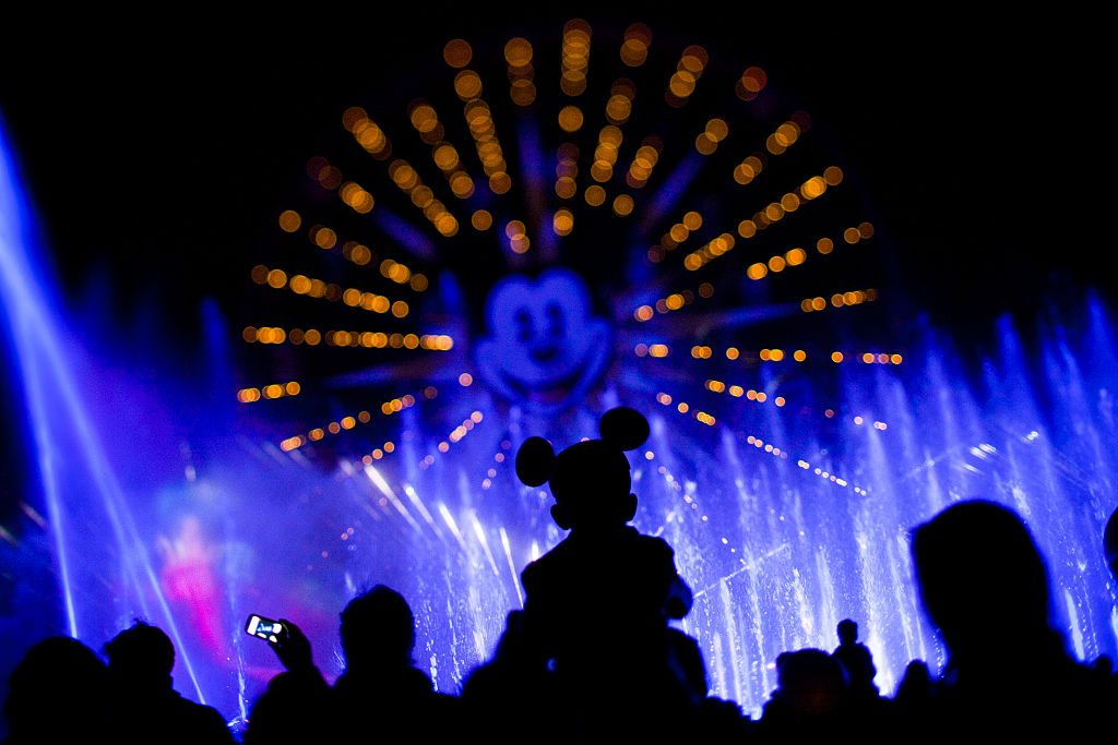 ANAHEIM, CA ––FEBRUARY 02, 2011––A child and his Mickey Mouse ears are silohuetted against the Worl