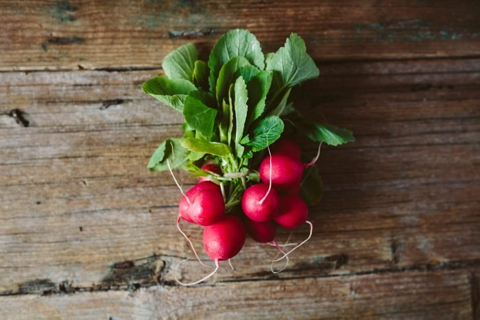 Bunch of red radishes on wood
