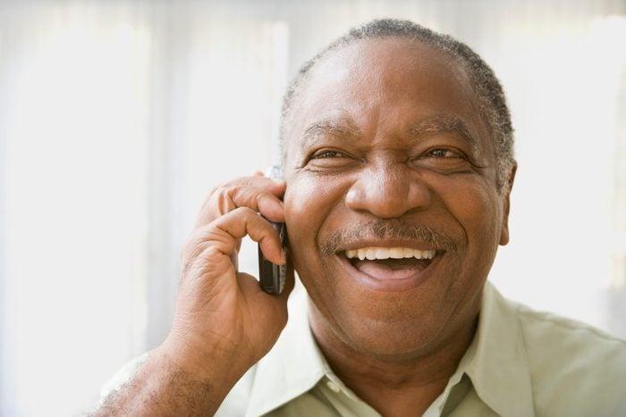 Senior African man talking on cell phone