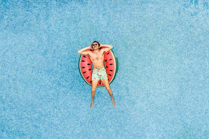 Man relaxing at swimming pool