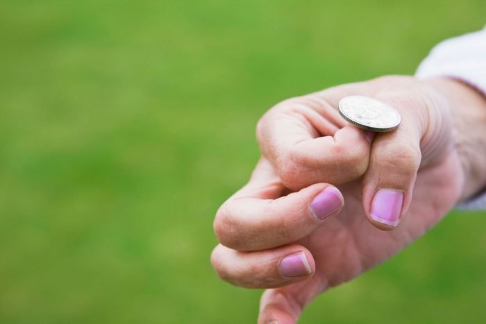 Woman flipping a coin