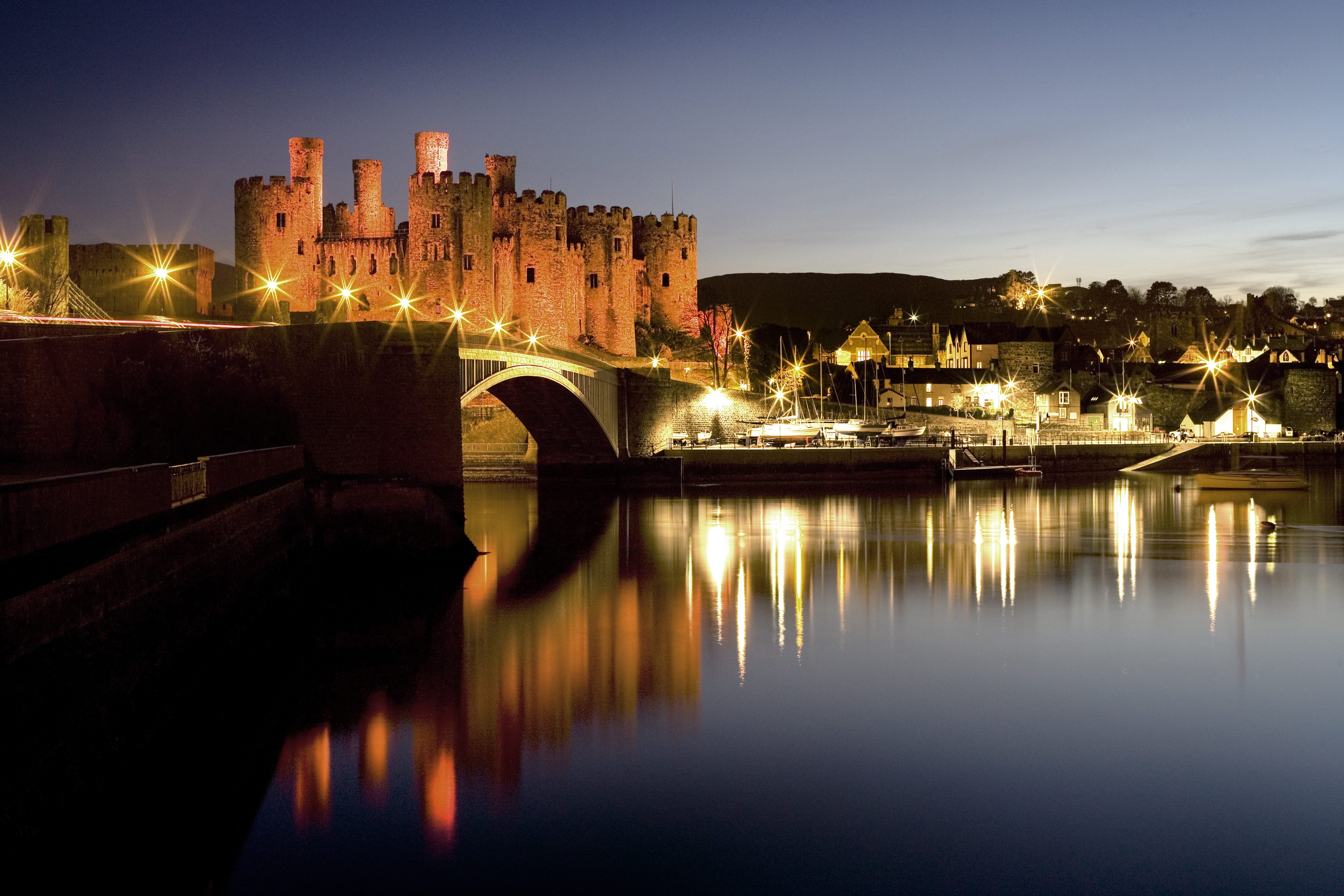 The View of the monumental Conwy Castle over the river Conwy at night, Wales, UK.
