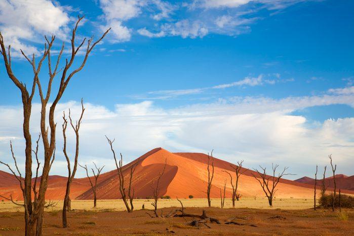 Desert mountain and plain against beautiful blue sky