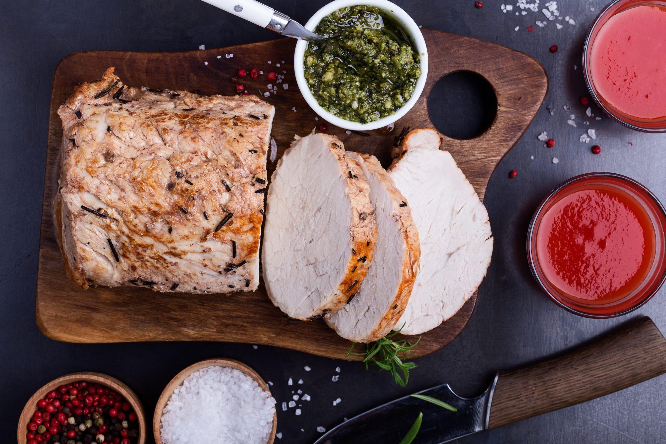 Herb roasted pork loin on cutting board