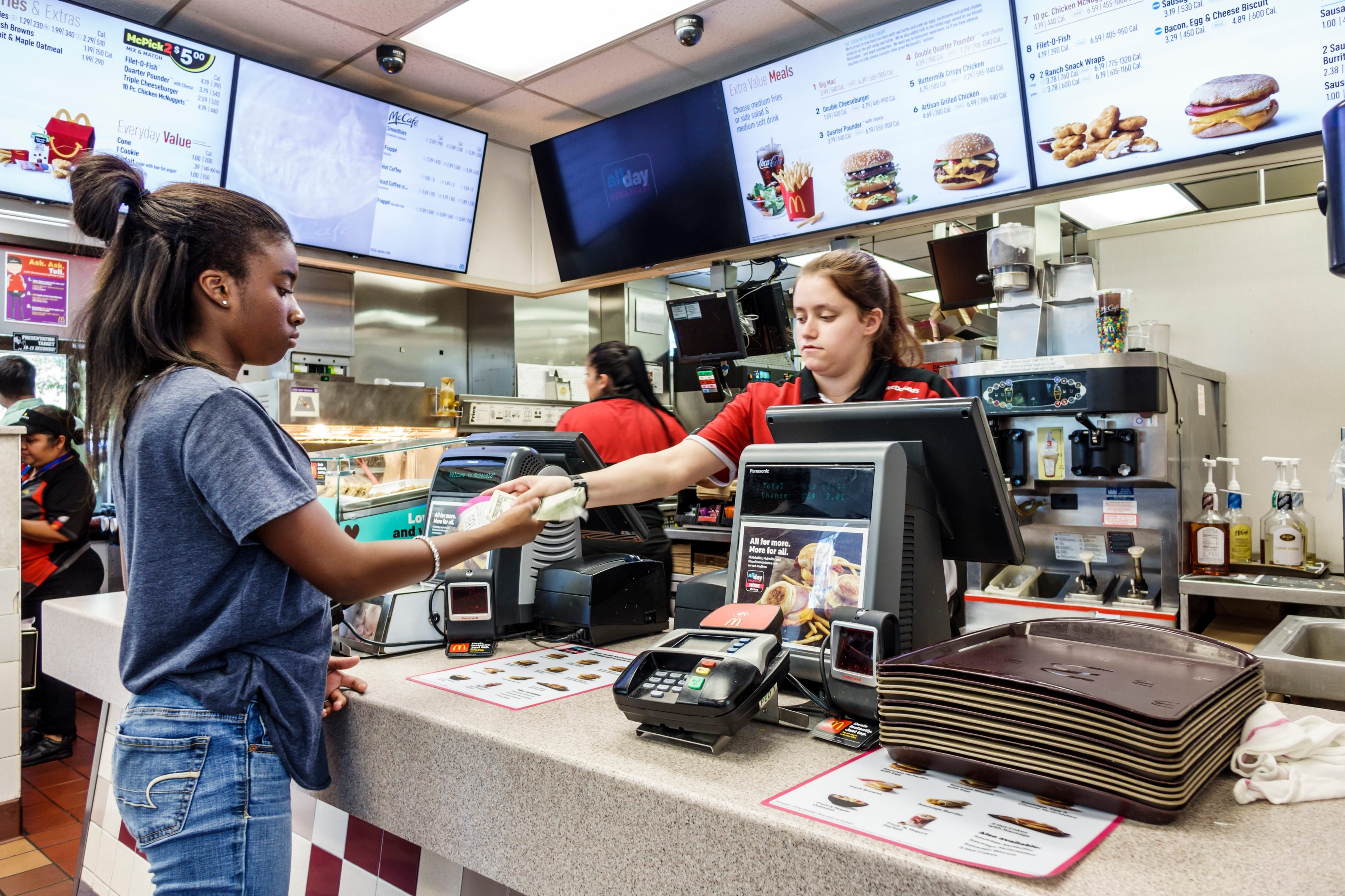 Florida, Vero Beach, McDonald's Fast Food restaurant Cashier giving change to Customer