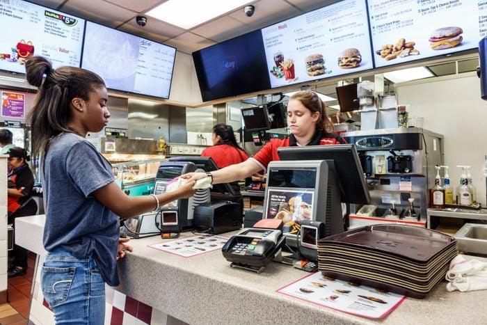Florida, Vero Beach, McDonald's Fast Food restaurant Cashier giving change to Customer