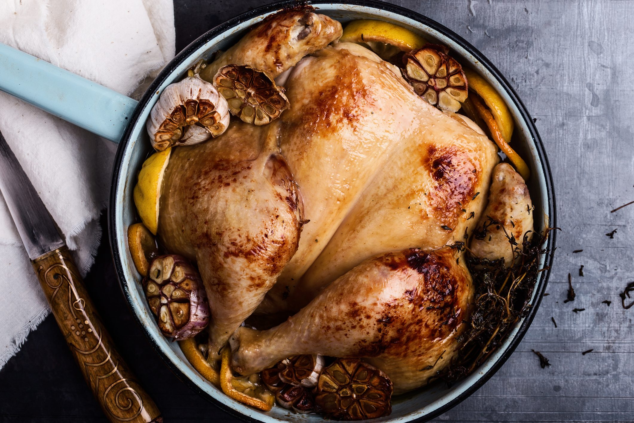 Homemade roasted chicken with spices, thyme and lemon