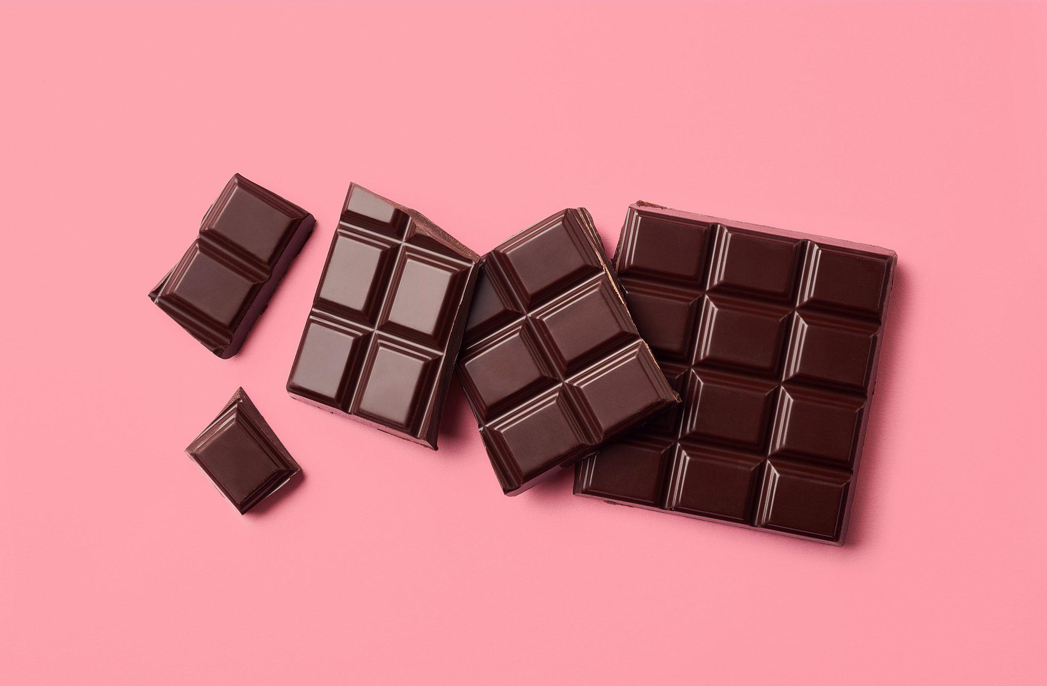 Dark chocolate on pink background