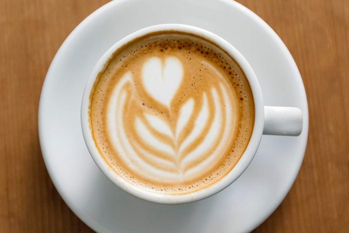 View of coffee cup with latte art straight from above