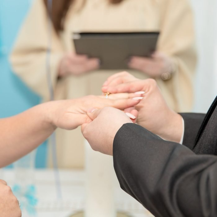 Wedding ceremony with rings and lawyer