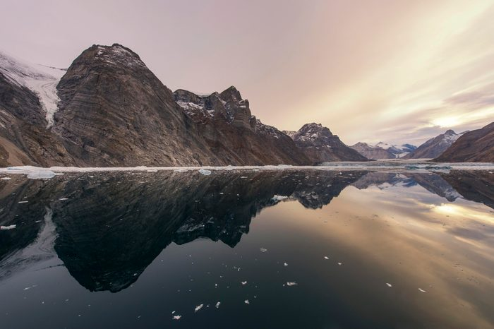 Reflection in the water, mountains and icebergs, Kaiser Franz Josef Fjord, Kejser Franz Josef Fjord, Northeast Greenland National Park, Greenland