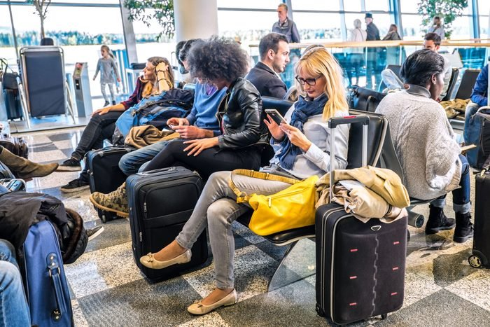 crowded passenger waiting lounge area in an airport