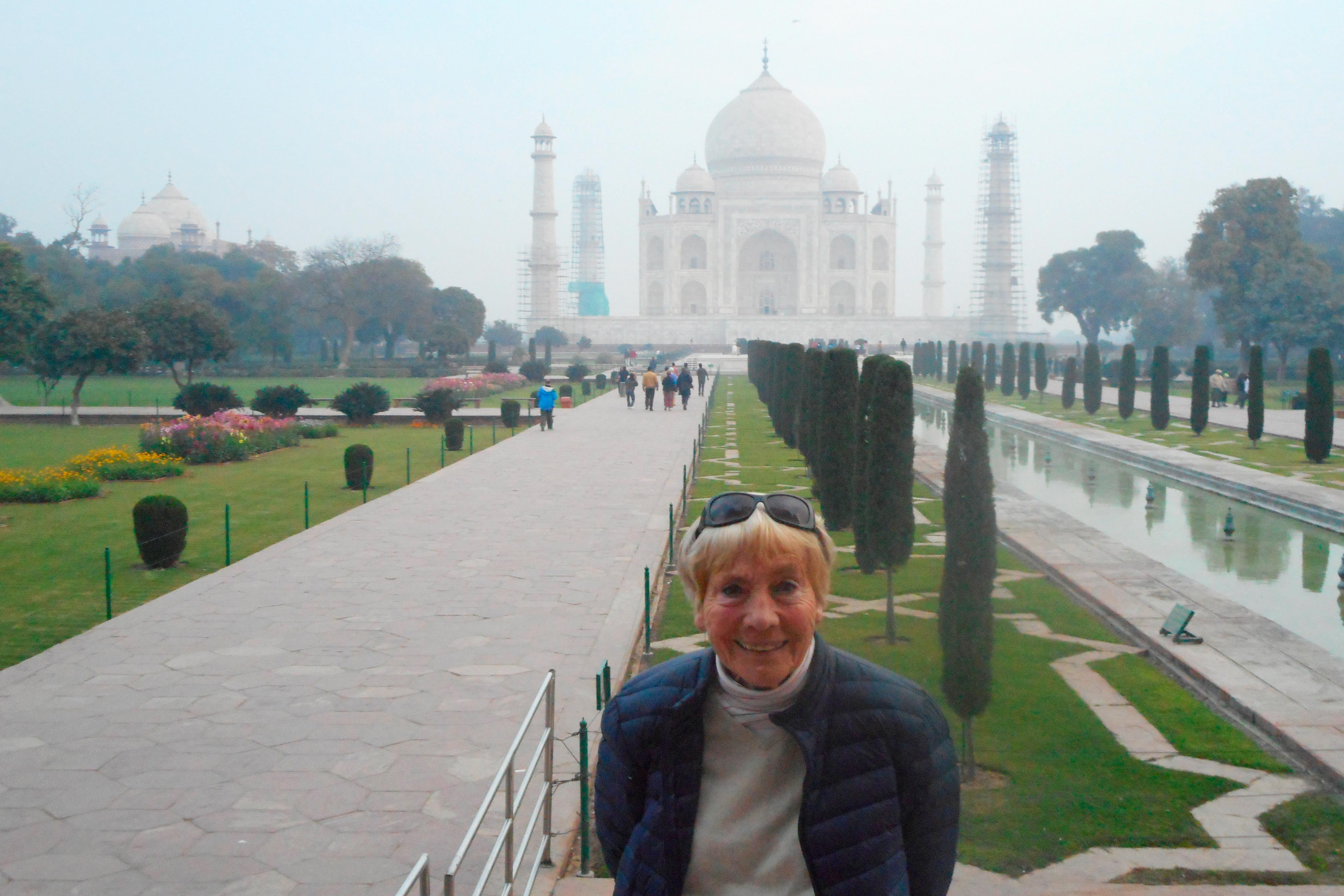 woman with taj mahal in the background