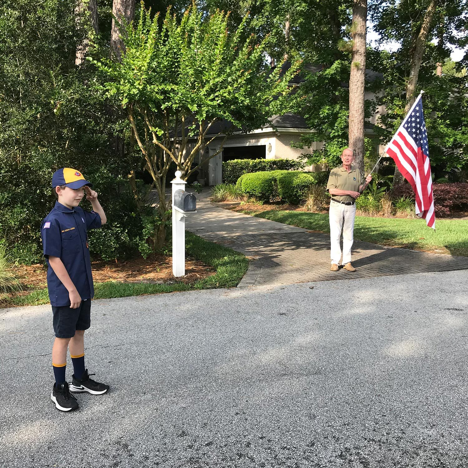 Retired naval officer brings families together to raise the flag