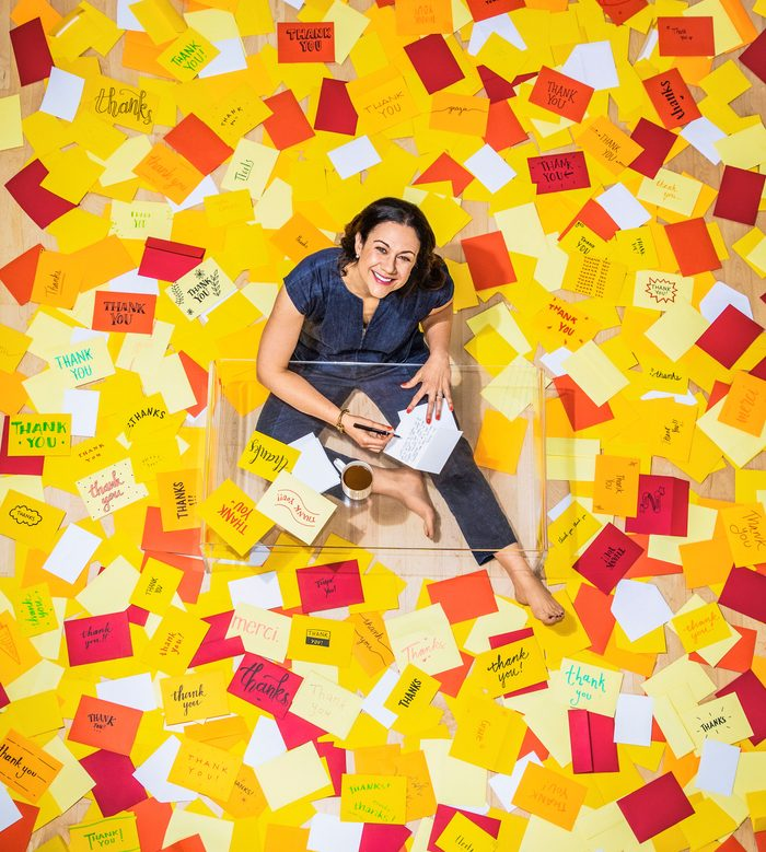 gina hamadey from above surrounded by thank you envelopes