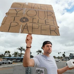 Jonny Blue holding his sign that reads,