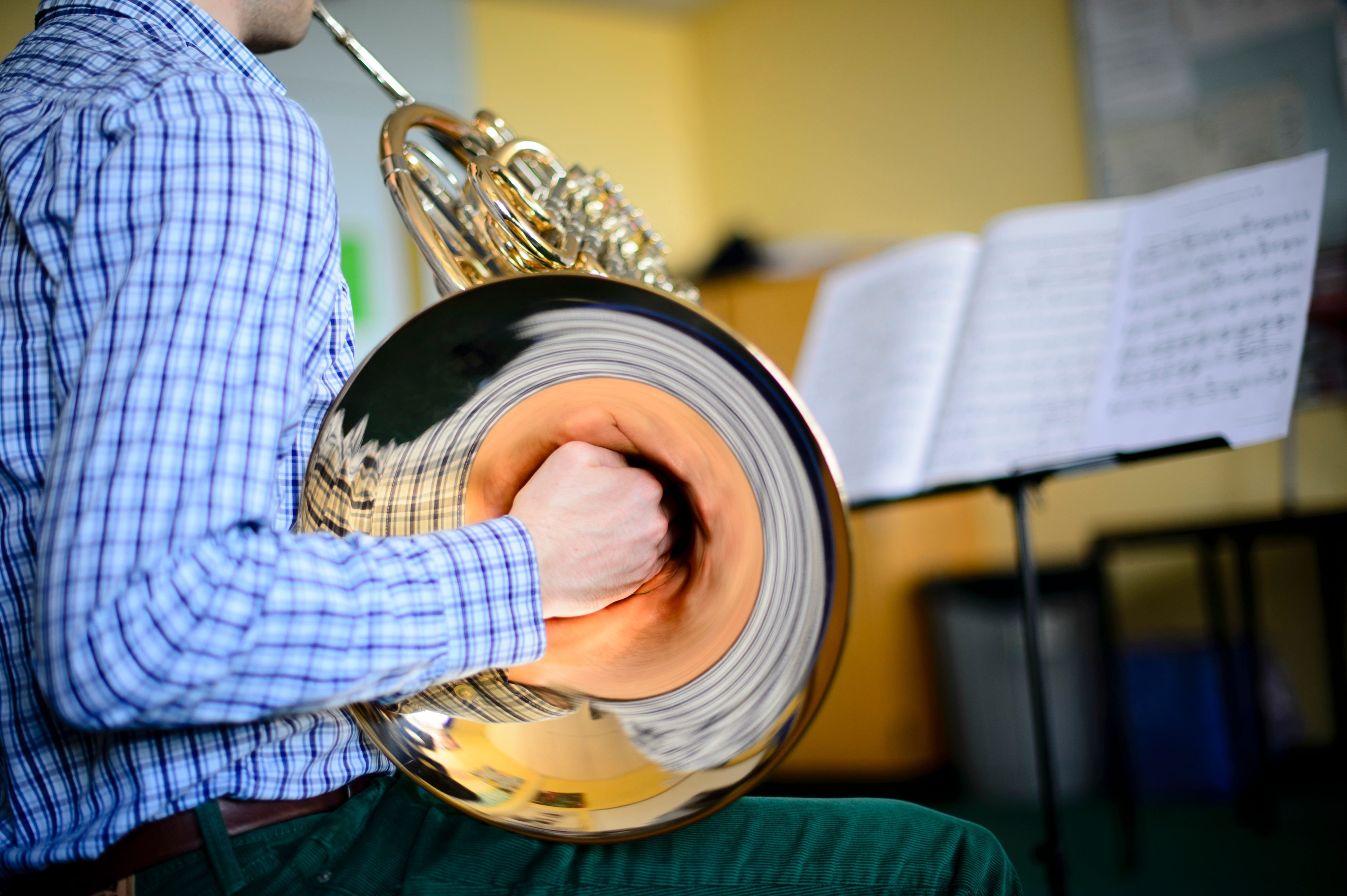 A Young male musician practicising french horn, part of Aberystwyth Arts Centre's MusicFest 2014
